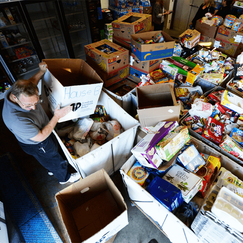Volunteer going through boxes at West Alabama Food Bank