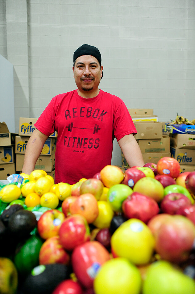 A man with apples at the West Alabama Food Bank